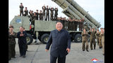 """This Saturday, Aug. 24, 2019, photo provided Sunday, Aug. 25, by the North Korean government, shows North Korean leader Kim Jong Un, center, smiles after the test firing of an unspecified missile at an undisclosed location in North Korea. North Korea fired two suspected short-range ballistic missiles off its east coast on Saturday in the seventh weapons launch in a month, South Korea's military said, a day after it vowed to remain America's biggest threat in protest of U.S.-led sanctions on the country. The content of this image is as provided and cannot be independently verified. Korean language watermark on image as provided by source reads: """"KCNA"""" which is the abbreviation for Korean Central News Agency. (Korean Central News Agency/Korea News Service via AP)"""