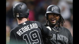 Pittsburgh Pirates' Josh Bell, left, celebrates with on-deck batter Colin Moran after hitting a two-run home run off Cincinnati Reds relief pitcher Kevin Gausman in the seventh inning of a baseball game Saturday, Aug. 24, 2019, in Pittsburgh. (AP Photo/Keith Srakocic)