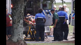 A injured golf fan is loaded into an ambulance after being struck lightning near the practice range during third round play in the Tour Championship golf tournament Saturday, Aug. 24, 2019, at East Lake Golf Club in Atlanta. (AP Photo/John Bazemore)