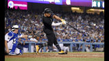 New York Yankees' Aaron Judge hits a solo home run next to Los Angeles Dodgers catcher Will Smith during the third inning of a baseball game Friday, Aug. 23, 2019, in Los Angeles. (AP Photo/Mark J. Terrill)