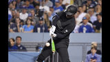 New York Yankees' Didi Gregorius hits a grand slam during the fifth inning of the team's baseball game against the Los Angeles Dodgers on Friday, Aug. 23, 2019, in Los Angeles. (AP Photo/Mark J. Terrill)