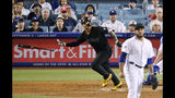 New York Yankees' Gleyber Torres, left, tosses his bat while running to first after hitting a solo home run off Los Angeles Dodgers relief pitcher Yimi Garcia, right, during the sixth inning of a baseball game Friday, Aug. 23, 2019, in Los Angeles. (AP Photo/Mark J. Terrill)