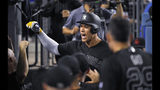 New York Yankees' Aaron Judge is congratulated by teammates in the dugout after hitting a solo home run during the third inning of the team's baseball game against the Los Angeles Dodgers on Friday, Aug. 23, 2019, in Los Angeles. (AP Photo/Mark J. Terrill)