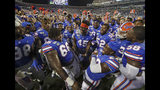 Florida players celebrate after defeating Miami 24-20 in an NCAA college football game Saturday, Aug. 24, 2019, in Orlando, Fla. (AP Photo/John Raoux)