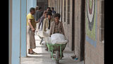 Displaced Yemenis receive food supplies provided by the World Food Programme, at a school in Sanaa, Yemen, Sunday, Aug. 25, 2019. The U.N. humanitarian chief in Yemen warned last Wednesday that unless significant new funding is received in the coming weeks, food rations for 12 million people in the war-torn country will be reduced and at least 2.5 million malnourished children will be cut off from life-saving services. (AP Photo/Hani Mohammed)