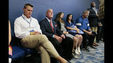 Indianapolis Colts general manager Chris Ballard, left, and owner Jim Irsay, second from left, listen as Colts quarterback Andrew Luck speaks during a news conference following the team's NFL preseason football game against the Chicago Bears, Saturday, Aug. 24, 2019, in Indianapolis. The oft-injured star is retiring at age 29. (AP Photo/AJ Mast)