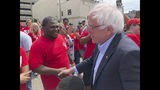 Democratic presidential candidate Sen. Bernie Sanders greets striking telecommunications workers on Sunday, Aug. 25, 2019, during a stop in Louisville, Ky. Sanders spoke to the striking workers before attending a rally to promote Democratic initiatives being bottled up in the Republican-led Senate. (AP Photo/Bruce Schreiner)