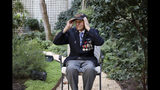 Steven Melnikoff, 99, of the 175th regiment of the 29th infantry division and is one of the few veterans left who took part to the D-Day landings on June 06, 1944, adjusts his cap during an interview with the Associated Press Friday, Aug.23, 2019 in Paris. Melnikoff was part of a group of World War II veterans taking part in commemorations of the 75th anniversary of the Allied operation to liberate Paris from Nazi occupation. (AP Photo/Daniel Cole)