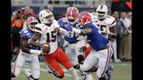 Miami quarterback Jarren Williams (15) tries to scramble before he is sacked by Florida linebacker Jonathan Greenard, left, defensive lineman Adam Shuler, center, and defensive lineman Jabari Zuniga, right, during the first half of an NCAA college football game Saturday, Aug. 24, 2019, in Orlando, Fla. (AP Photo/John Raoux)
