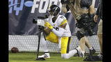 Pittsburgh Steelers wide receiver JuJu Smith-Schuster jokes with a photographer's camera after catching a 17-yard touchdown pass against the Tennessee Titans in the first half of a preseason NFL football game Sunday, Aug. 25, 2019, in Nashville, Tenn. (AP Photo/James Kenney)