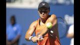 Ashleigh Barty, of Australia, returns the ball as she practices for the U.S. Open tennis tournament Saturday, Aug. 24, 2019, in New York. (AP Photo/Eduardo Munoz Alvarez)