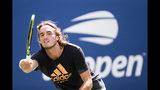 Stefanos Tsitsipas, of Greece, watches a return during practice for the U.S. Open tennis tournament Saturday, Aug. 24, 2019, in New York. (AP Photo/Eduardo Munoz Alvarez)