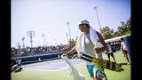 Rafael Nadal, of Spain, leaves the practice courts at the U.S. Open tennis tournament Saturday, Aug. 24, 2019, in New York. (AP Photo/Eduardo Munoz Alvarez)