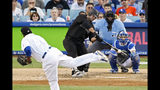 New York Yankees' Mike Ford hits an RBI double thrown from Los Angeles Dodgers relief pitcher Pedro Baez as catcher Austin Barnes, right, and home plate umpire Bill Welke watch during the eighth inning of a baseball game Sunday, Aug. 25, 2019, in Los Angeles. (AP Photo/Mark J. Terrill)