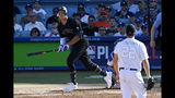 New York Yankees' Aaron Judge, left, runs to first as he hits a solo home run as Los Angeles Dodgers starting pitcher Clayton Kershaw watches during the third inning of a baseball game Sunday, Aug. 25, 2019, in Los Angeles. (AP Photo/Mark J. Terrill)
