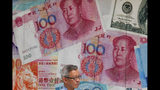 Una tienda con imágenes de monedas chinas en Hong Kong, el 6 de agosto del 2019. (AP Photo/Kin Cheung, File)