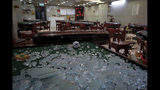 Broken glass scattered around a mahjong shop operated by mainland Chinese and damaged by demonstrators during a protest in Hong Kong, Sunday, Aug. 25, 2019. Police in Hong Kong used tear gas Sunday to clear pro-democracy demonstrators who had taken over a street and brought out water cannon trucks for the first time in the summer long protests. (AP Photo/Vincent Yu)