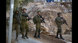 Israeli forces patrol near the area of an attack, west of the West Bank city of Ramallah, Sunday, Aug. 25. 2019. An explosion Friday near a West Bank settlement that Israel said was a Palestinian attack killed a 17-year-old Israeli girl and wounded her brother and father, Israeli authorities said. (AP Photo/Majdi Mohammed)