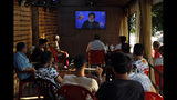 People listen to a speech by Hezbollah leader Sayyed Hassan Nasrallah being broadcast on Hezbollah's al-Manar TV channel, at a coffee shop in a southern suburb of Beirut, Lebanon, Sunday Aug. 25, 2019. Nasrallah said Hezbollah will confront and shoot down Israeli drones that fly over Lebanon from now on. (AP Photo/Bilal Hussein)
