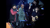 """Musician Stevie Wonder, left, is escorted by comedian Dave Chappelle during the """"Gem City Shine,"""" event in the Oregon District in Dayton, Ohio, Sunday, Aug. 25, 2019. Chappelle, who resides in nearby Yellow Springs, hosted the special block party and benefit concert for those affected by the recent mass shooting. (Marshall Gorby/Dayton Daily News via AP)"""