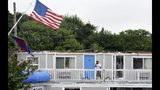 FILE - In this July 23, 2019 file photo, a steel flag pole bows to the wind framing the second floor of the Cape Sands Inn where a tornado touched down ripping the second floor on the structure in West Yarmouth, Mass. Local chamber of commerce data suggests Cape Cod lodging and beach visit numbers are down after uncommon tornados hit just one year after a pair of shark attacks. (Steve Heaslip/The Cape Cod Times via AP, File)