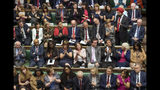 """In this handout photo provided by the House of Commons, Labour MP Tanmanjeet Singh Dhesi, standing, speaks during Boris Johnson's first Prime Minister's Questions, in the House of Commons in London, Wednesday, Sept. 4, 2019. A lawmaker for Britain's opposition Labour Party has gotten an unusual round of applause after challenging Prime Minister Boris Johnson to apologize for comparing Muslim women who wear face-covering veils to """"letter boxes."""" Dhesi asked Johnson to say he was sorry for the """"derogatory and divisive"""" remarks in a newspaper column. (Jessica Taylor/House of Commons via AP)"""