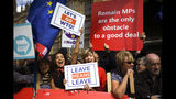 Pro-Brexit supporters outside the Houses of Parliament, in London, Wednesday, Sept. 4, 2019. The European Union is warning businesses and people likely to be hit by Brexit to make sure they are prepared for the possibility that Britain might leave the bloc without an agreement at the end of next month. The EU's executive arm, the European Commission, on Wednesday released a checklist for companies to use to help minimize expected disruptions to trade after Britain departs on Oct 31. (AP Photo/Alberto Pezzali)