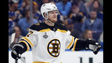 FILE - In this June 1, 2019, file photo, Boston Bruins defenseman Torey Krug celebrates a teammate's goal against the St. Louis Blues during the first period of Game 3 of the NHL hockey Stanley Cup Finals, in St. Louis. Krug says there have been no talks with the Bruins on a new contract with one season left to unrestricted free agency. Despite a breakout playoff performance that helped the Bruins get to Game 7 of the Stanley Cup Final, Krug is stuck in neutral while the front office focuses on signing restricted free agents Brandon Carlo and Charlie McAvoy. (AP Photo/Jeff Roberson, File)