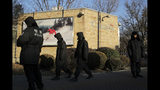 """FILE - In this Dec. 12, 2018, file photo, policemen patrol outside the Canadian Embassy in Beijing. China on Thursday, Sept. 5, 2019, has urged Canada to """"reflect on its mistakes"""" and immediately release a Huawei executive detained in Vancouver. (AP Photo/Andy Wong, File)"""