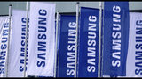 Flags of the Samsung company wave in front of a fairground entrance of the IFA 2019 tech fair in Berlin, Germany, Wednesday, Sept. 4, 2019. The IFA takes place in Berlin from Sept. 6 until Sept. 11, 2019. (AP Photo/Michael Sohn)