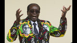 FILE - In this Saturday, Dec, 17, 2016 file photo, Zimbabwean President Robert Mugabe addresses people at an event before the closure of his party's 16th Annual Peoples Conference in Masvingo, south of the capital Harare. On Friday, Sept. 6, 2019, Zimbabwe President Emmerson Mnangagwa said his predecessor Mugabe, age 95, has died. (AP Photo/Tsvangirayi Mukwazhi, File)