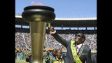 FILE - In this Wednesday, April 18, 2012 file photo Zimbabwe President Robert Mugabe, lights a flame at celebrations to mark 32 years of independence of Zimbabwe, in Harare. On Friday, Sept. 6, 2019, Zimbabwe President Emmerson Mnangagwa said his predecessor Mugabe, age 95, has died. (AP Photo/File)
