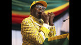 FILE - In this Friday, Dec. 7, 2012 file photo Zimbabwean President Robert Mugabe clenches his fists as he delivers his speech at his party's 13th annual conference, in Gweru about 250 Kilometres south west of the capital Harare. On Friday, Sept. 6, 2019, Zimbabwe President Emmerson Mnangagwa said his predecessor Mugabe, age 95, has died. (AP Photo/Tsvangirayi Mukwazhi, File)