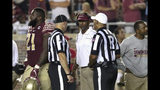 Florida State's head coach Willie Taggart, center, confers with officials concerning a call in the fourth quarter of an NCAA college football game against Louisiana-Monroe, Saturday, Sept. 7, 2019, in Tallahassee Fla. (AP Photo/Steve Cannon)