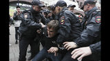 FILE - In this Saturday, Aug. 17, 2019 file photo, Police detain an activist during a protest in the center of Moscow, Russia, . People rallied Saturday against the exclusion of some city council candidates from Moscow's upcoming election. A seemingly second-tier local election has evolved into a major challenge to Russia's President Vladimir Putin, triggering the biggest protests against his rule in seven years and causing divisions among his top lieutenants. (AP Photo/File)