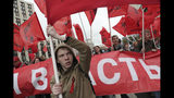 FILE - In this Saturday Aug. 17, 2019 file photo, Communist party supporters wave red flags during a protest in the center of Moscow, Russia, Saturday, Aug. 17, 2019. A seemingly second-tier local election has evolved into a major challenge to Russia's President Vladimir Putin, triggering the biggest protests against his rule in seven years and causing divisions among his top lieutenants. (AP Photo/File)