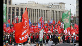 FILE - In this Saturday, Aug. 17, 2019 file photo, Communist party supporters wave red flags during a protest in the center of Moscow, Russia. A seemingly second-tier local election has evolved into a major challenge to Russia's President Vladimir Putin, triggering the biggest protests against his rule in seven years and causing divisions among his top lieutenants. (AP Photo/Alexander Zemlianichenko, File)