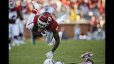 Oklahoma wide receiver CeeDee Lamb (2) sails over a South Dakota defender in the first quarter of an NCAA college football game Saturday, Sept. 7, 2019, in Norman, Okla. (AP Photo/Sue Ogrocki)