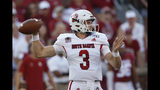 South Dakota quarterback Austin Simmos (3) throws in the first throws in the quarter of an NCAA college football game against Oklahoma Saturday, Sept. 7, 2019, in Norman, Okla. (AP Photo/Sue Ogrocki)