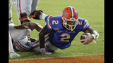 Florida running back Lamical Perine, right, dives over the goal line for a touchdown against UT Martin on a 5-yard run during the second half of an NCAA college football game, Saturday, Sept. 7, 2019, in Gainesville, Fla. (AP Photo/John Raoux)
