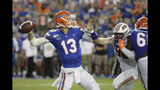 Florida quarterback Feleipe Franks (13) throws a 69-yard touchdown pass to receiver Van Jefferson during the first half of an NCAA college football game against UT Martin, Saturday, Sept. 7, 2019, in Gainesville, Fla. (AP Photo/John Raoux)