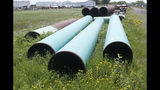 FILE - In this June 29, 2018, file photo, pipeline used to carry crude oil is shown at the Superior terminal of Enbridge Energy in Superior, Wis. The divisive fight over the future of a crude oil pipeline across Minnesota highlights the dilemmas for Democrats in a state that's expected to become a battleground in the 2020 presidential race. And that could spell opportunity for President Donald Trump, who came close to winning the historically red state in 2016. (AP Photo/Jim Mone, File)