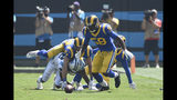 Carolina Panthers wide receiver D.J. Moore fumbles while Los Angeles Rams inside linebacker Cory Littleton (58) and linebacker Bryce Hager (54) scramble to recover during the first half an NFL football game in Charlotte, N.C., Sunday, Sept. 8, 2019. (AP Photo/Mike McCarn)