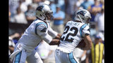 Carolina Panthers quarterback Cam Newton (1) hands off to running back Christian McCaffrey (22) during the first half an NFL football game against the Los Angeles Rams in Charlotte, N.C., Sunday, Sept. 8, 2019. (AP Photo/Mike McCarn)
