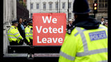 A pro-brexit campaigner holds a banner near Parliament in London, Monday, Sept. 9, 2019. British Prime Minister Boris Johnson voiced optimism Monday that a new Brexit deal can be reached so Britain leaves the European Union by Oct. 31. (AP Photo/Kirsty Wigglesworth)