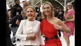 Carolina Herrera, left, poses with model Karlie Kloss before Herrera's namesake collection is modeled during Fashion Week, in New York, Monday, Sept. 9, 2019. (AP Photo/Richard Drew)