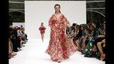 CORRECTS CAPTION AND BYLINE FOE FASHION CAROLINA HERRERA - The Carolina Herrera collection is modeled during Fashion Week, in New York, Monday, Sept. 9, 2019. (AP Photo/Richard Drew)