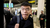 Hong Kong activist Joshua Wong arrives at Tegel airport in Berlin, Monday, Sept. 9, 2019. Wong, a leader of Hong Kong's 2014 pro-democracy protest movement, was among several people held last month and charged with inciting people to join a protest in June. Wong, who visited Taiwan last week, told reporters before he flew off to Germany and then the U.S. that he would continue to raise global awareness about Hong Kong's fight for democratic reforms. (Christoph Soeder/dpa via AP)