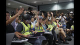 In a sign of protest against the police using force against the media, journalists wear protective gear during a police media conference in Hong Kong, Monday, Sept. 9, 2019. Hong Kong's government agreed last week to withdraw an extradition bill that sparked a summer of protests, but demonstrators want other demands to be met, including direct elections of city leaders and an independent inquiry into police actions. (AP Photo/Kin Cheung)