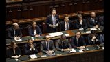 Italian Premier Giuseppe Conte, standing at center, sits with his cabinet ministers as he addresses parliament ahead of confidence vote later at the Lower Chamber in Rome, Monday, Sept. 9, 2019. Conte is pitching for support in Parliament for his new left-leaning coalition ahead of crucial confidence votes. (AP Photo/Andrew Medichini)